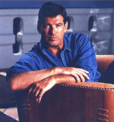 pierce_brosnan_sitting_in_pacific_green_sofa