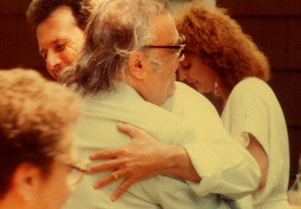 Attorney Bert Fields warmly embraces his friend, Mario Puzo, author of 'The Godfather.'